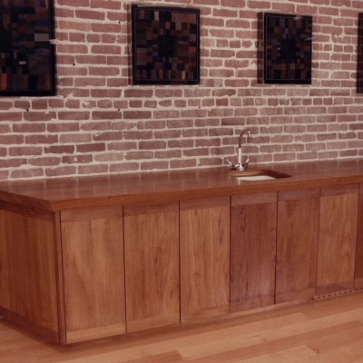 A large built-in cabinet with sink for a conference room.