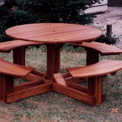 Teak table with benches and hole for umbrella