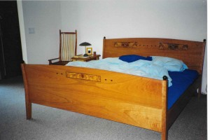 custom cherry bed with inlay