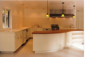 curved cherry kitchen counter and cabinets